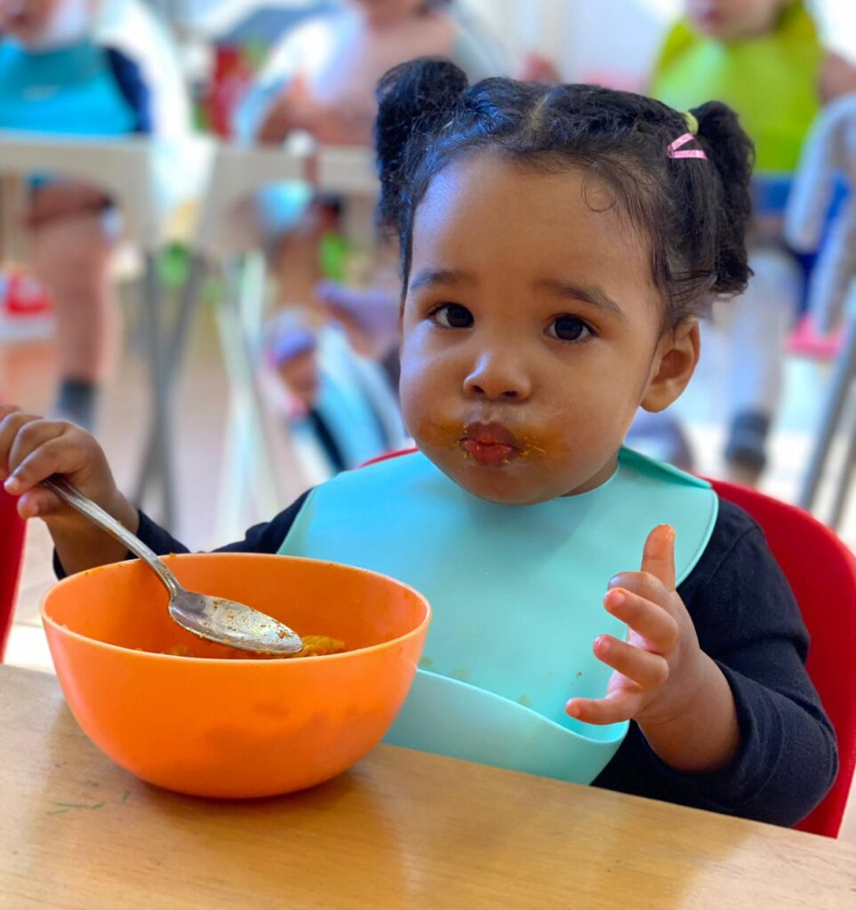 child eating pasta in the nursery