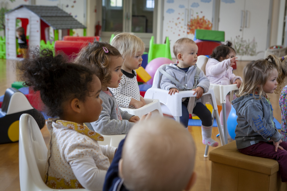 nursery toddlers sitting in chairs
