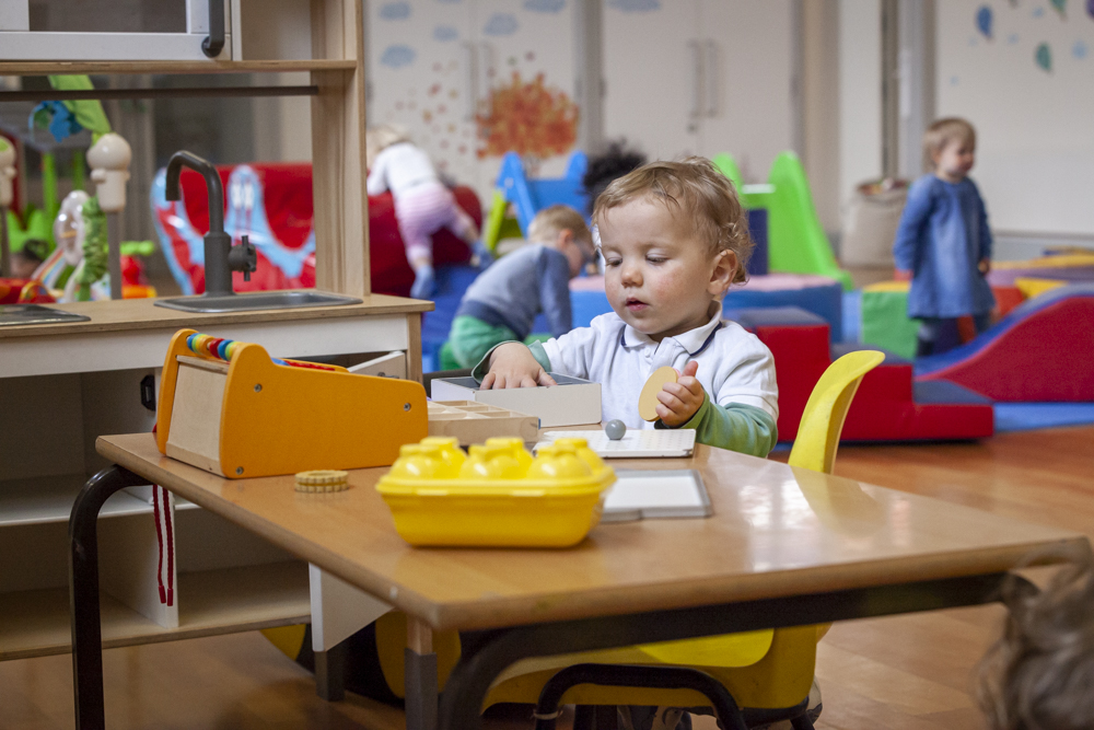 boy playing with blocks in pre school