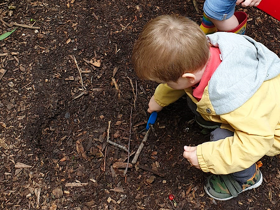 digging for treasure at forest school